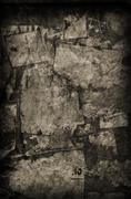 Vintage Torn Paper on Wall - stock photo