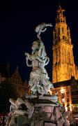 brabo fountain and cathedral of our lady (1352-1521), antwerp, belgium - stock photo