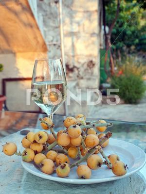 Stock photo of Glass of wine with fruits on table