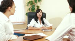 Young Women Discussing Business Issues in Office Stock Footage
