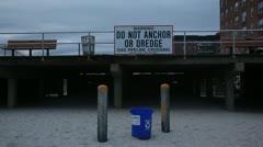 Warning Sign on Long Beach Long Island Boardwalk Stock Video - stock footage