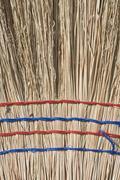 closeup of straw broom - stock photo