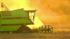 combine harvester sundown twilight - stock footage