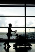 woman in transit at airport - stock photo