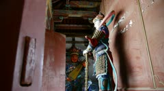 Chinese immortals Buddhist Vajra sculpture in carved beams painted buildings,an Stock Footage