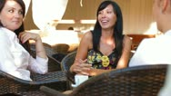 Stock Video Footage of Three Women at Outdoor Cafe