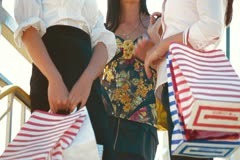 Women Carrying Shopping Bags Stock Footage