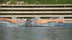Powerful slow motion butterfly swimmer Stock Footage
