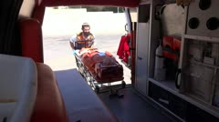 ambulance EMT train with doll - stock footage
