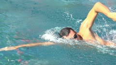 Side view of freestyle swimmer slow motion Stock Footage