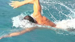 Slow motion freestyle swimming sideview Stock Footage