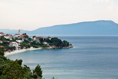 small town and blue island in dalmatia, croatia - stock photo