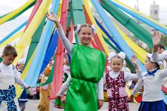 children with may pole - stock photo
