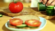 Stock Video Footage of Slicing tomatoes and cucumber
