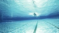 Stock Video Footage of freestyle swimmer under water passing camera