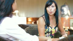 Female Friends Informal Conversation in Outdoor Cafe Stock Footage