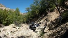 Sport 4x4 vehicle climbing rough steep mountain trail HD 016 Stock Footage