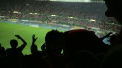 soccer fans in stadium after a missed goal - stock footage