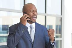 successful african american businessman talking on cell phone - stock photo