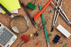 Office supplies in a mess on the table Stock Photos