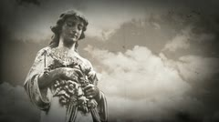 goth gravestone statue angel with timelapse clouds - stock footage