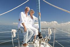 happy senior couple on a sail boat - stock photo