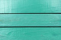 Fragment of wooden turquoise fence Stock Photos