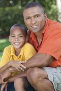 Happy african american father and son family outside Stock Photos