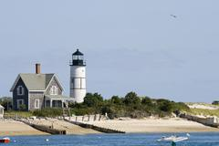 lighthouse and home at cape cod - stock photo