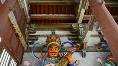 Chinese immortals Buddhist Vajra sculpture holding a pipa lute instruments in c Stock Footage