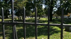 Slow Motion Graveyard Glide-Cam in front of fence - stock footage