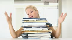 Portrait of businesswoman overwhelmed with large pile of work Stock Footage