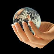 earth in hand - stock illustration