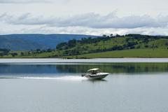 speedboat on inland hydroelectric lake, furnas - stock photo