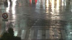 Fast motion of Shibuya pedestrian crossing,car traffic, rainy night,Tokyo,Japan - stock footage