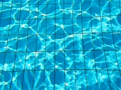 Wawes in pool. Sun Reflections. Stock Footage