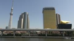 Timelapse Tokyo Sky Tree, Asahi Breweries Headquarters in Sumida,Tokyo,Japan Stock Footage
