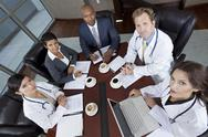Interracial medical business team meeting in boardroom Stock Photos