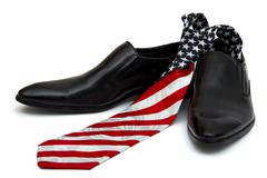 Black man's shoes and necktie with a coloring in style of a flag of america Stock Photos