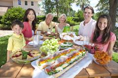 Parents grandparents children family healthy eating outside Stock Photos