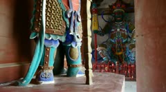 Chinese immortals Buddhist samurai Vajra sculpture in carved beams painted buil Stock Footage