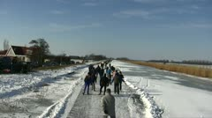 Ice skating in the countryside from the Netherlands Stock Footage