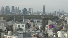 Fast motion of Aerial view of Shinjuku by day,Tokyo, Japan - stock footage