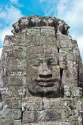 Stone face of Bodhisattva Lokesvara - stock photo