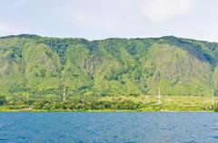 Lake Toba and surrounding mountains - stock photo