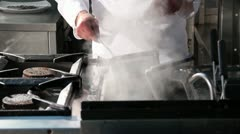 Preparation of a dish in the kitchen - stock footage