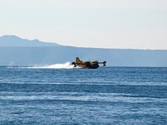 Fire fighter hydroplane on blue sea - stock photo