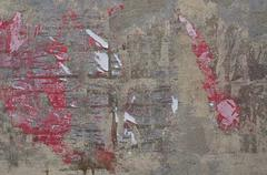 torn paper on wall - stock photo