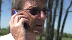 Elderly man on cell phone slow motion Stock Footage