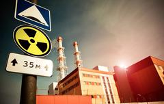 Nuclear power plant with radioactivity sign Stock Photos